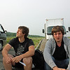 Andrey & Ivan sitting by the roadside.