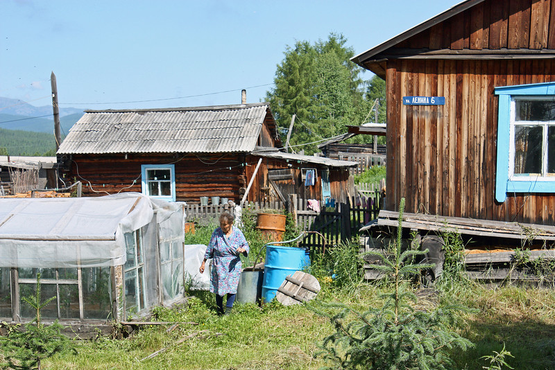 Village yard with greenhouse.