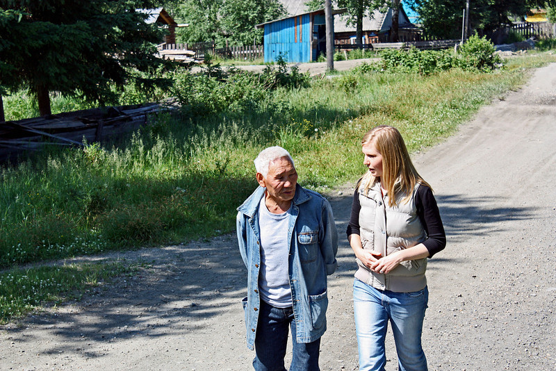 Alice interviewing an Arkady Khokhlov, one of the village leaders.