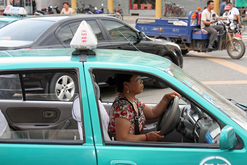 Woman taxi driver.