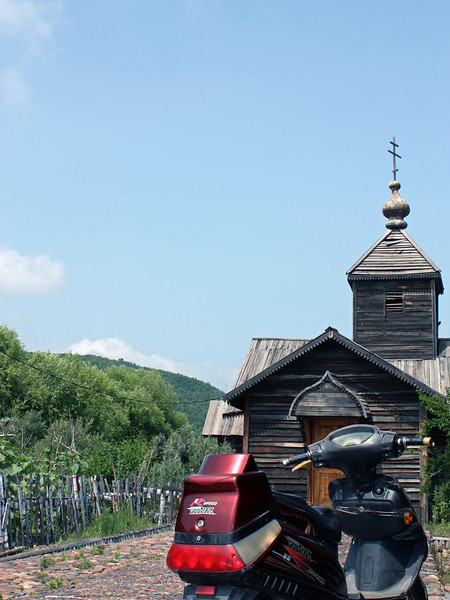 Motorcycle & traditional Russian church at Heihe's Ethnographic Museum.
