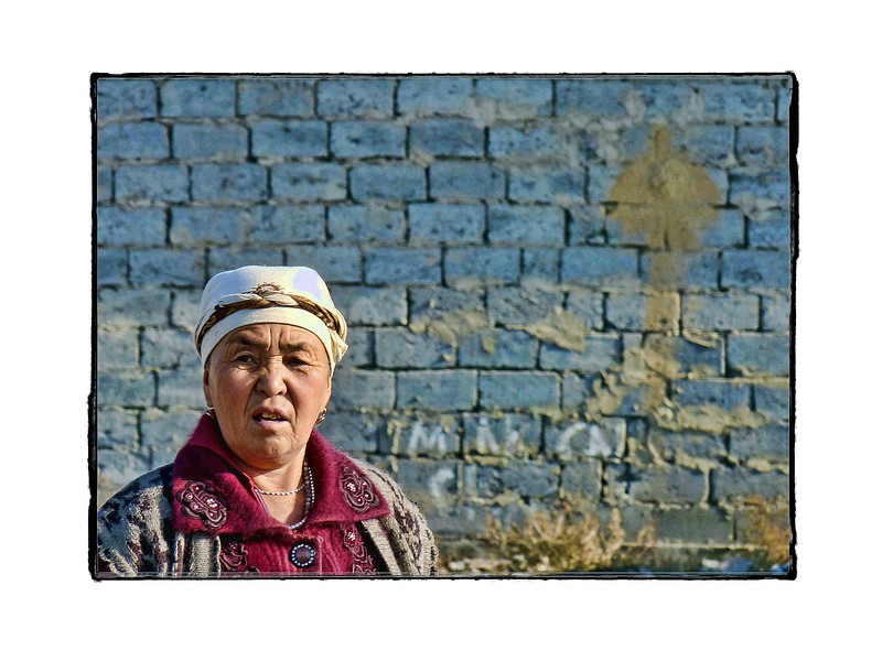Migrant worker in front of housing she & others are building on the outskirts of Bishkek, Kyrgyzstan