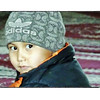 Kyrgz boy in a Bishkek mosque.