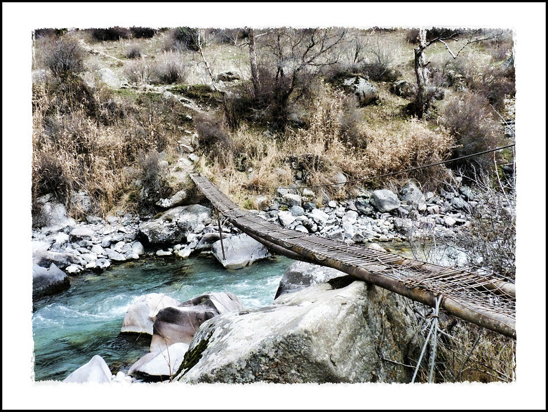 Make shift bridge across a river in Kyrgyzstan.