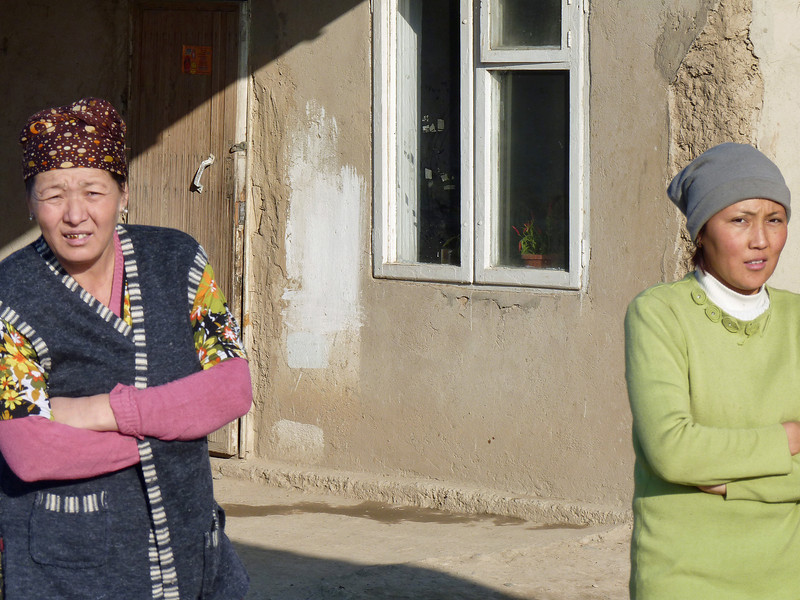 Women in front of their home.