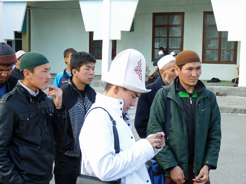 Young men outside the mosque.