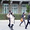 Students at the American University. Студентки Американского университета в Бишкеке идут с занятий.