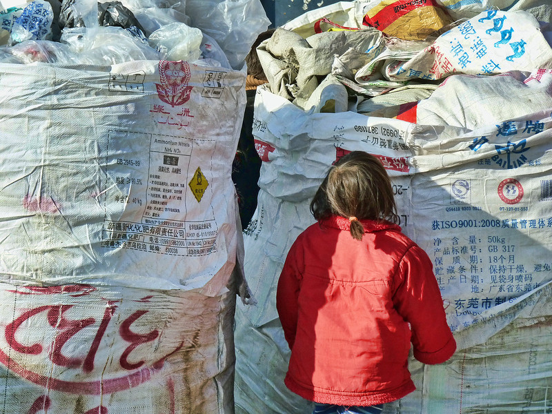 Little one trying to help in the Bishkek market.