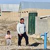 Father and daughter walking towards the wtaer source - a pump. Новая водоколонка в пригороде Бишкека. Теперь воду не надо привозить машинами.