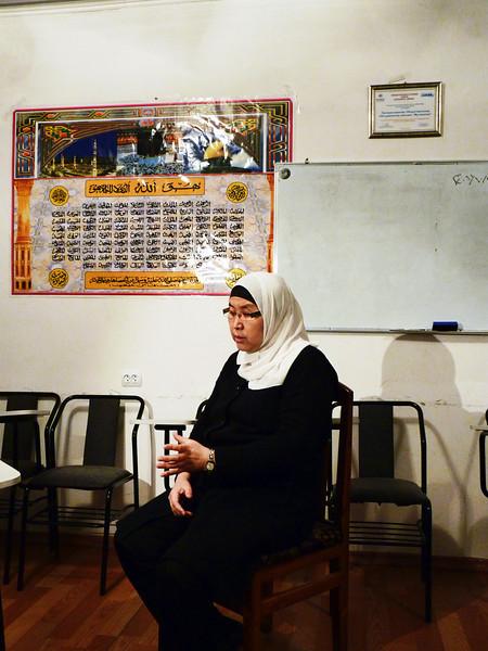 Jamal Frantbek Kizi, head of the Association of Muslim Women, in her office. Руководительница Ассоциации женщин-мусульманок Джамал Франтбек кызы в своем офисе.