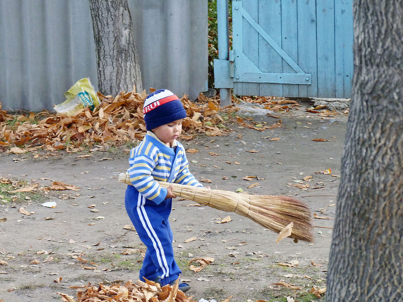 Sweeping the leaves.