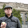 Eating an apple in front of the American University.