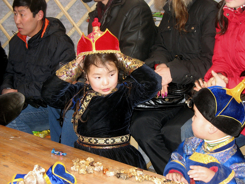My hat's prettier than yours. Children's New Year Celebration.  (Ulan-Ude, Russia)