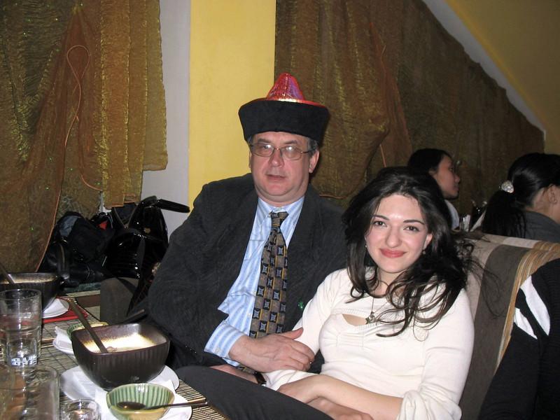 Rustem with Gayene wearing Buryat hat presented to him.