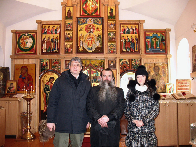 Inside Old Believers' Church with priest & RT correspondent, Gayene.
