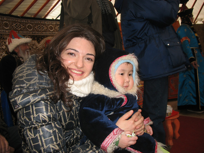RT Correspondent, Gayene, with Buryat baby.