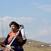 Buryat throat singer, Leonid Babalaev, playing a morin khuur on the steppe near Aginskoye. (Zabaikal Krai, Siberia)