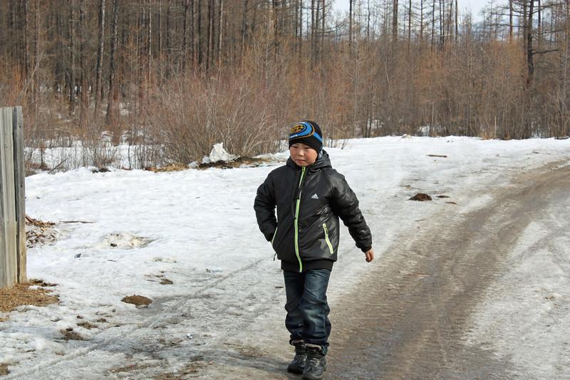 Evenk boy on the village road.