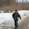 Evenk boy on the village road.