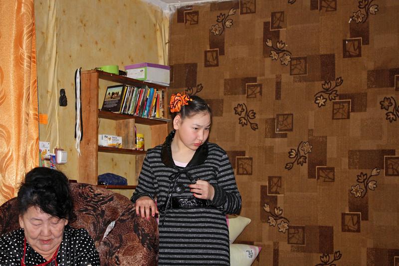 Galina Filippova & her grand-daughter in her home in the village of Chapo-Ologo.