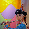 Buryat girl playing the flute.