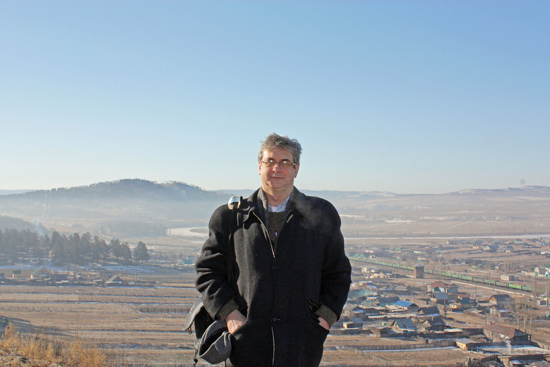 Rustem standing on a hilltop in the Aginsk Region of Transbaikal, Siberia.