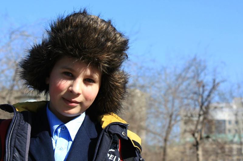 Читинский мальчик в мохнатой шапке.