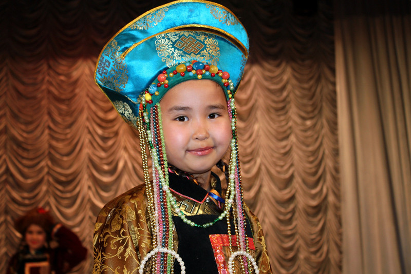 Buryat girl dressed in the latest fashion during a show at the Fashion Theater in Mogoytuy.