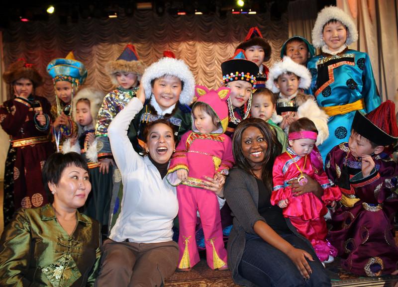 Rusiya Al-Yaum correspondent, Wafaa Daoui, & RT correspondent, Staci Bivens, with kids after the show.