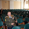 Waiting a conference to begin. Military men are always early.