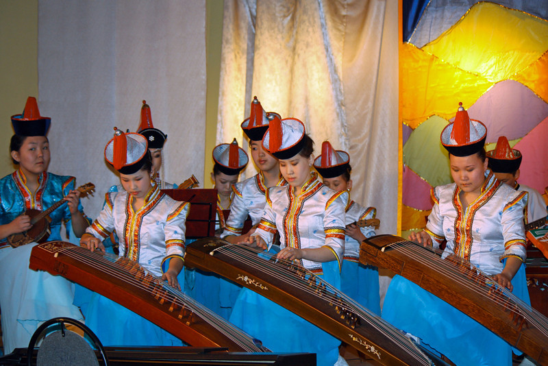 Buryat ladies playing the guzheng (Chinese name) or yatag (Mongolian name), an instrument related to the zither.