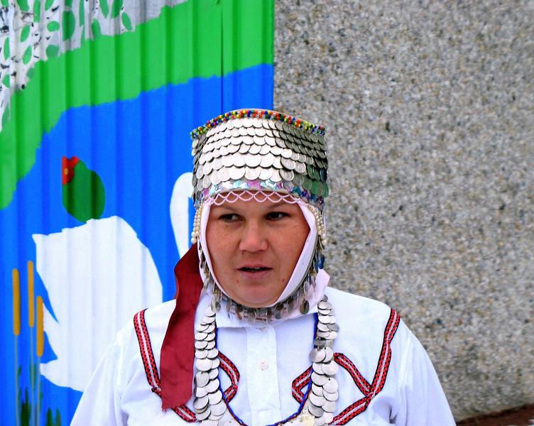 Beer brewer wearing Chuvash coin headdress.