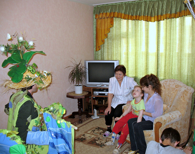 Puppeteer at the home of a disabled child. Municipal grants provide funding for local artists to entertain disabled kids in their homes.