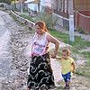 A Gypsy woman & her grandson fetching water. (Borovsk)