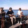 Making music on the embankment with traditional Karelian instruments.