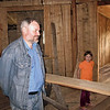 Leonid & his daughter in the yurt they're building - 8 years & still ongoing.