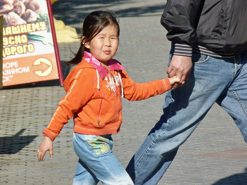 Khakass girl with her dad on the streets of Abakan.
