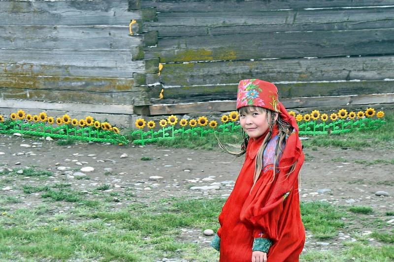 Girl in red with sunflowers. (Khakassia, Siberia, Russia)
