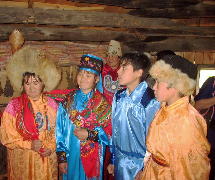 Children reenact a traditional Khakass wedding ceremony. The big hat worn by the woman on the left is a matchmaker's hat.