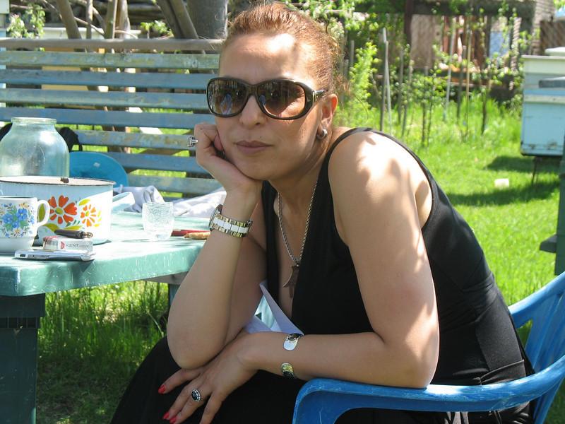 Wafaa, correspondent for our Arabic-language channel, enjoying tea in Vladimir's garden.