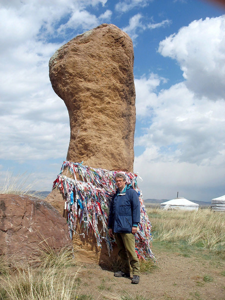 A giant phallus? Archeologists are uncertain. To this day, people place prayer ribbons around these sacred stones.