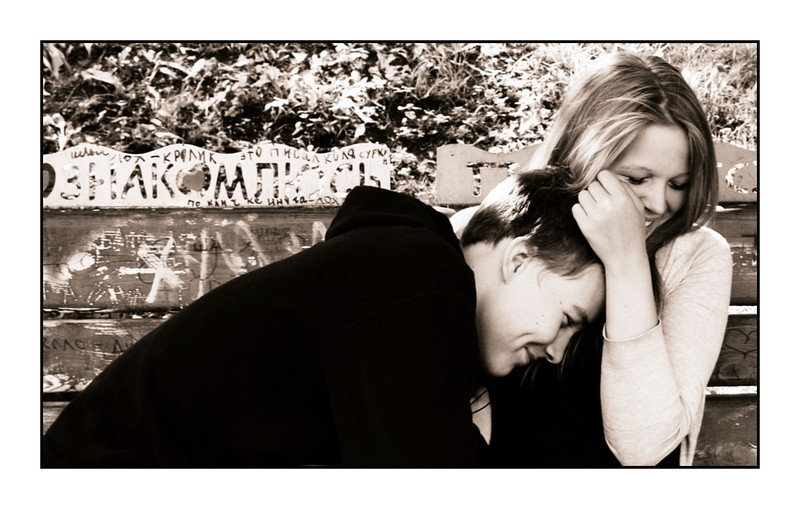 Young love. Couple on a park bench.