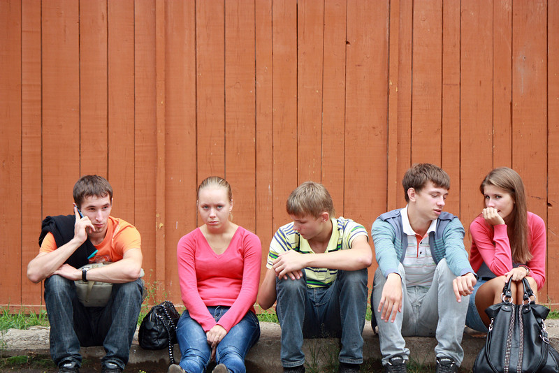 Teens watching from the sidelines.