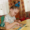 Doing a puzzle at the Nadezhda orphanage.