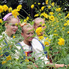 Maidens amongst the flowers. These young ladies were watching others perform while awaiting their turn at the recent Cucumber Festival. Праздник Истобенского огурца. Село Истобенск, Кировская область.