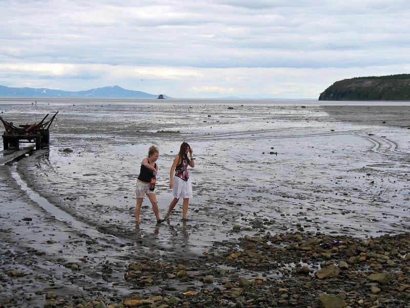 Girls walking the shoals at low tide. (Gertner Bay)