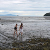 Girls walking the shoals at low tide. (Gertner Bay)