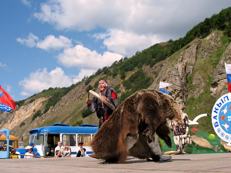 The show begins. Dancing with bear [skin].