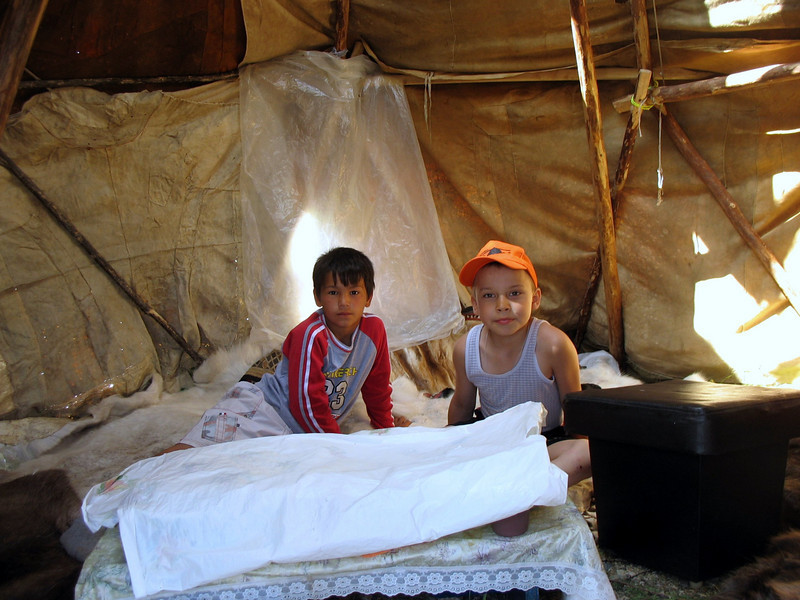 Two boys in their tent.