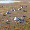 Approaching the reindeer cooperative near Karatkya. Nenets chums (teepee type tents) on the tundra as seen from helicopter.